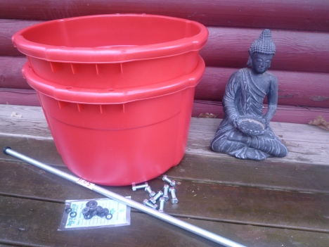 Two buckets, some bolts with nuts and rubber washers, a steel pipe, and a little help from Buddha.
