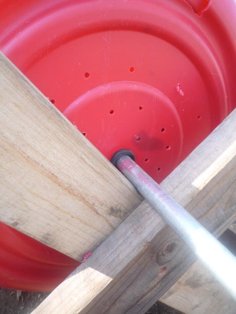 I drilled holes in each end for air circulation and rested the pipe on a pair of 2x4 saw horses. Crank handle to come.