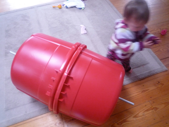 A fast-moving baby puts the near-finished compost bin in perspective.